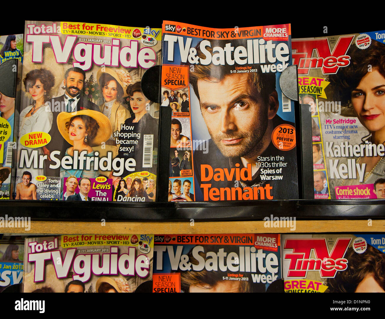 TV guides in a newsagents shop - Stock Image
