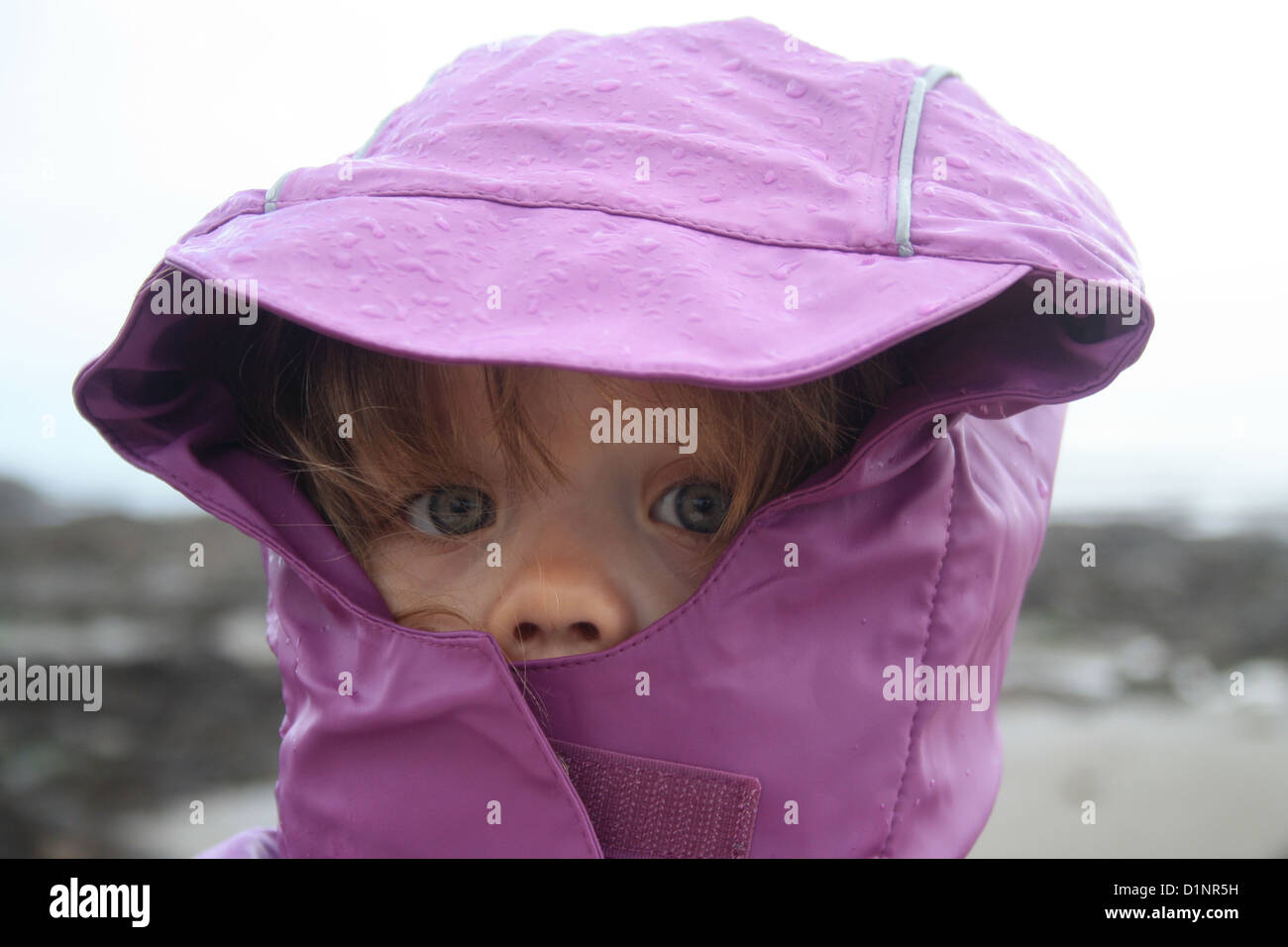 A girl wearing wet weather coat in the rain Stock Photo  52724941 ... ec20776c613
