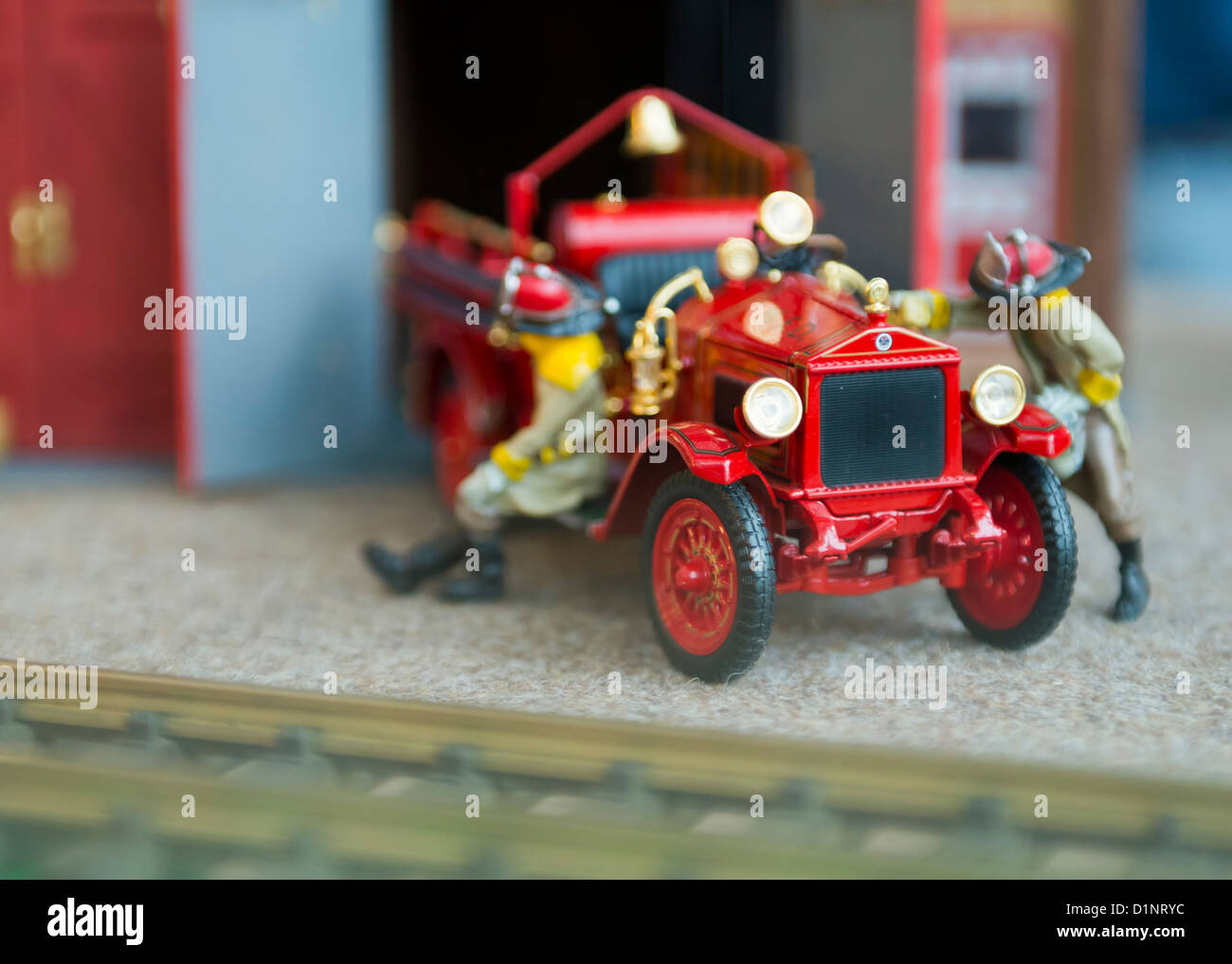 Model Of Vintage Fire Truck And 2 Firemen By Railway Tracks, Display At  Cradle Of