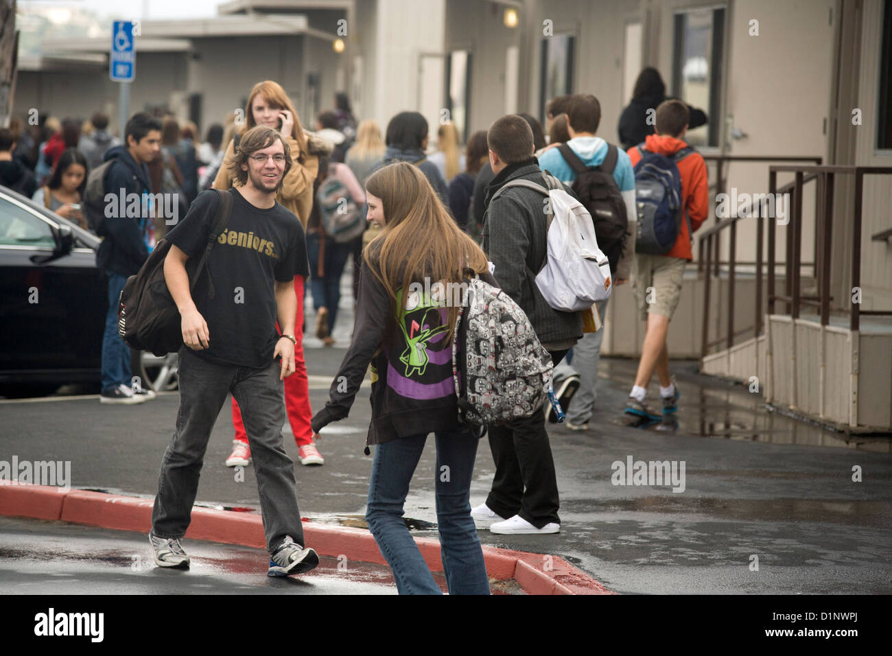 California high school students socialize during a class break. Note temporary classrooms to accommodate expanded - Stock Image