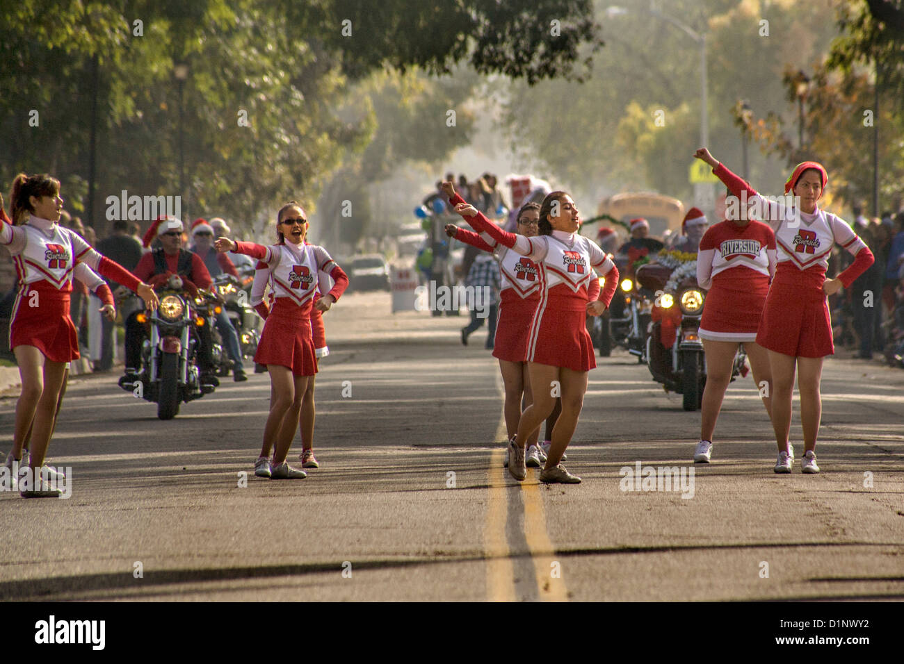 A team of deaf cheerleaders leads a Christmas parade at the California School for the Deaf in Riverside, CA. - Stock Image