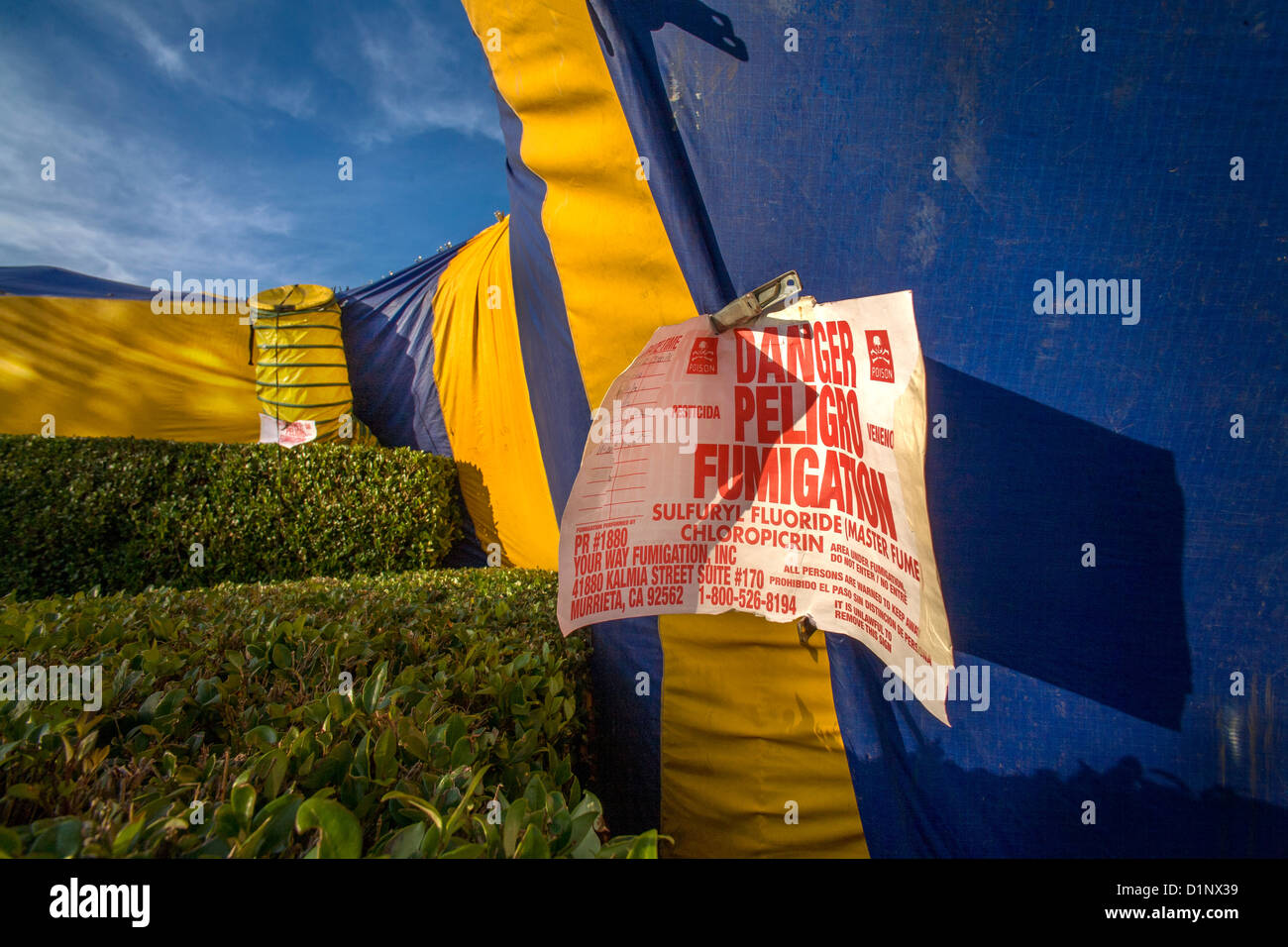 Sign outside a gas-proof tent warns against dangers sulfur fluoride chloropicrin poison gas during fumigation to - Stock Image