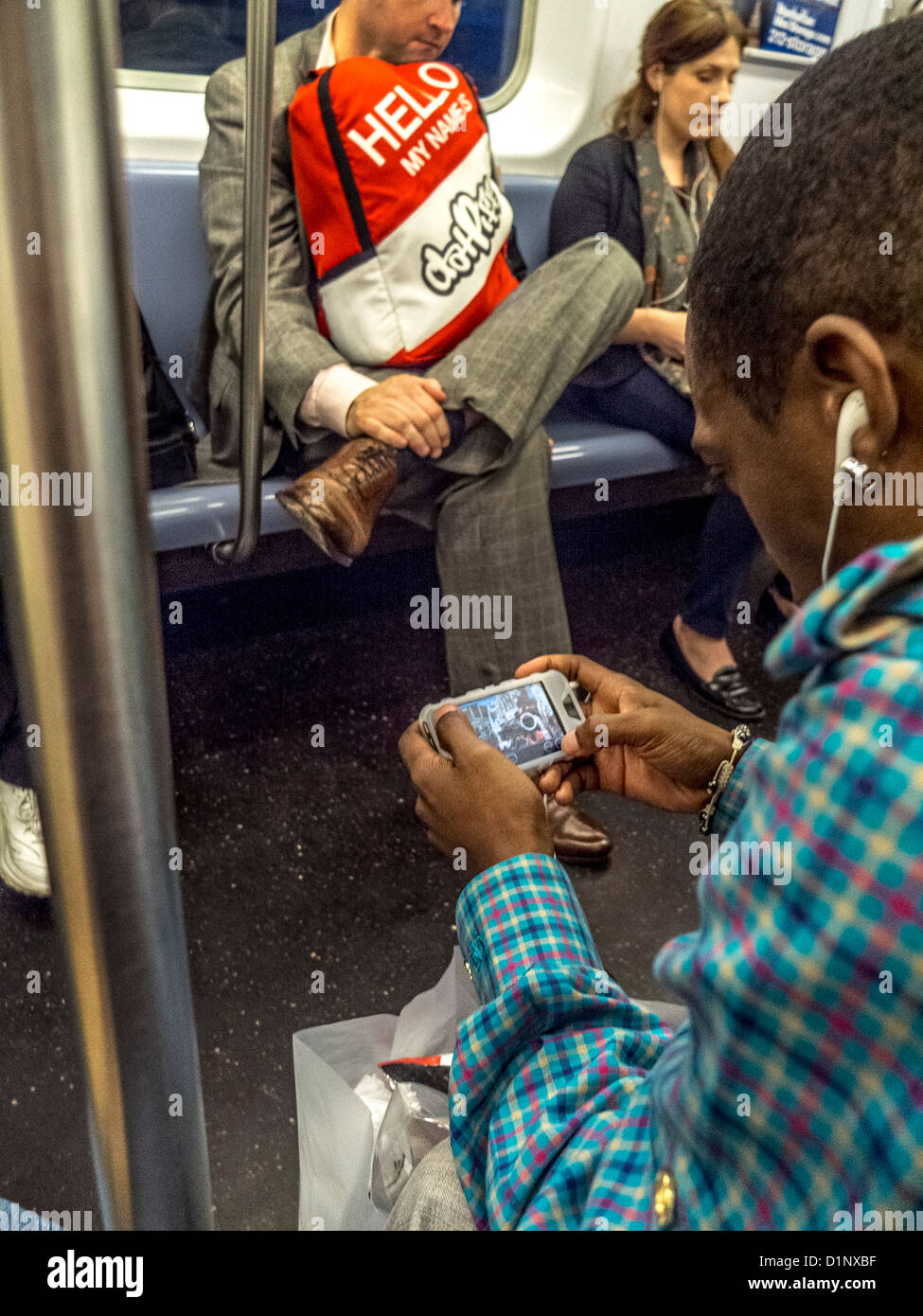 an african american man plays a video game on a smartphone while