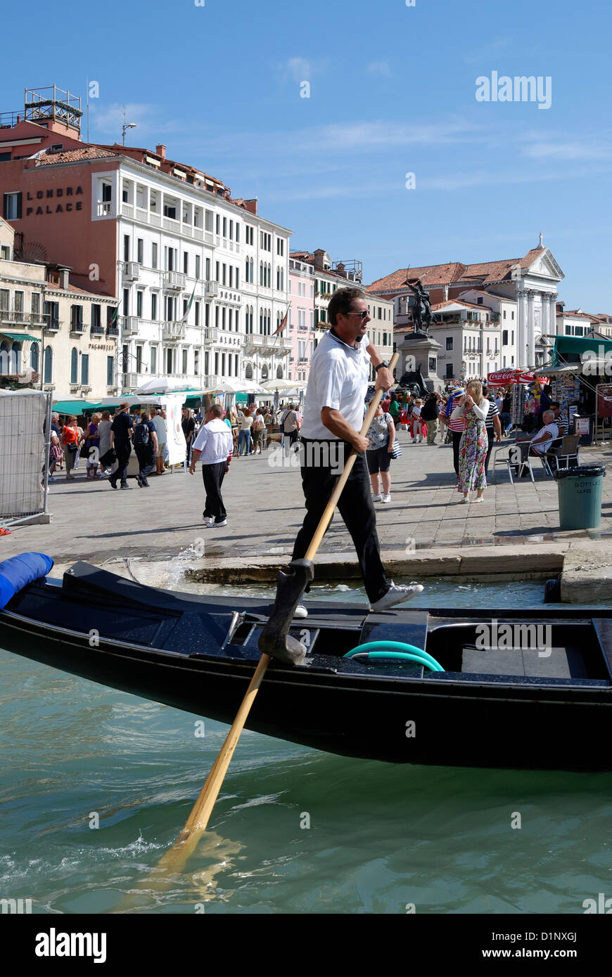 Gondolier at the Grand Canal in Venice. - Stock Image