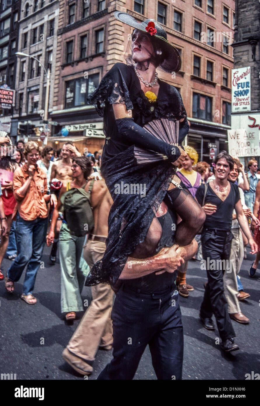 A female impersonater is carried down Boston's Tremont Street during a 1978 Gay Pride parade. - Stock Image