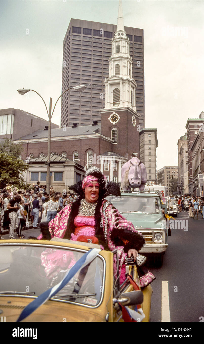 A female impersonator is driven down Boston's Tremont Street during a 1978 Gay Pride parade. Note Park Street - Stock Image