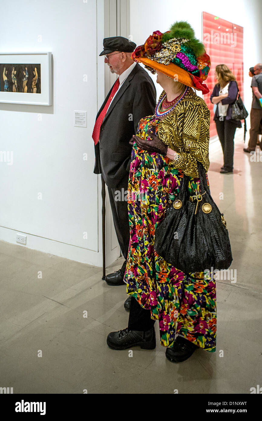 A colorfully dressed elderly couple attend an art museum exhibition opening night and reception in Newport Beach, - Stock Image