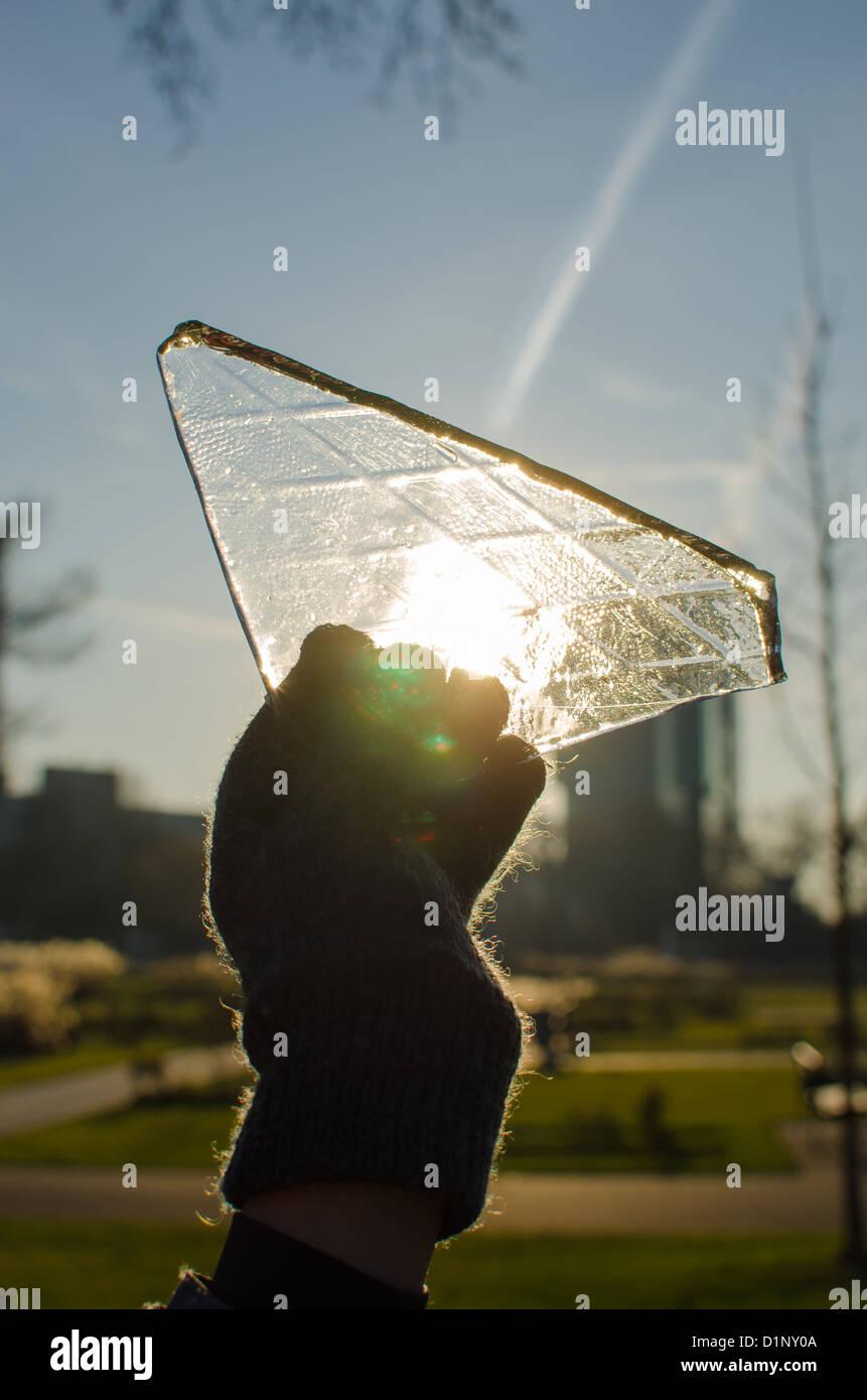 sun shining through an ice sheet - Stock Image