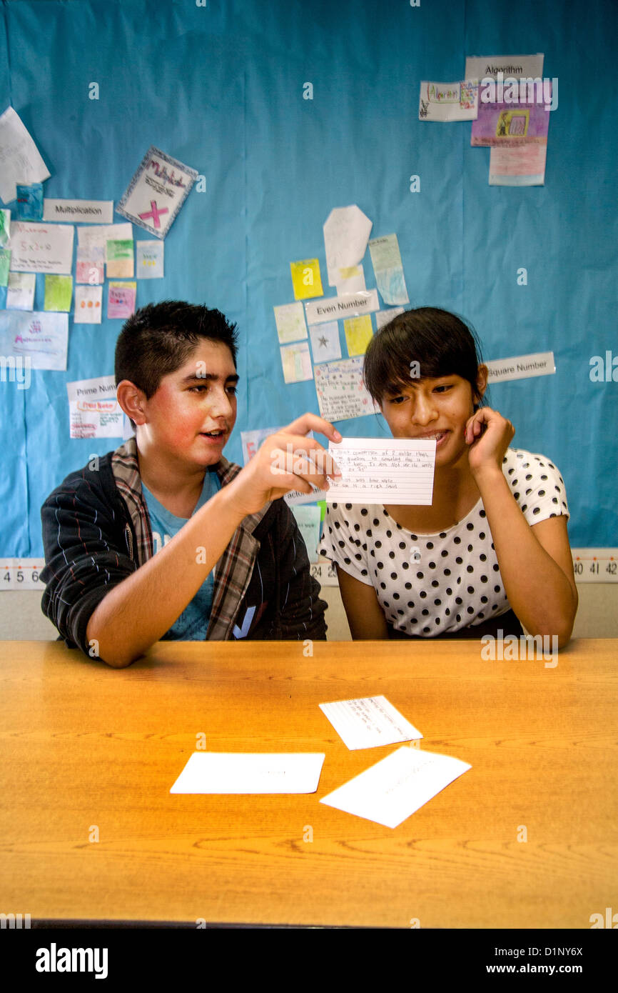 A Hispanic junior high school student tests his classmate's math skills using flash cards in a San Clemente, - Stock Image