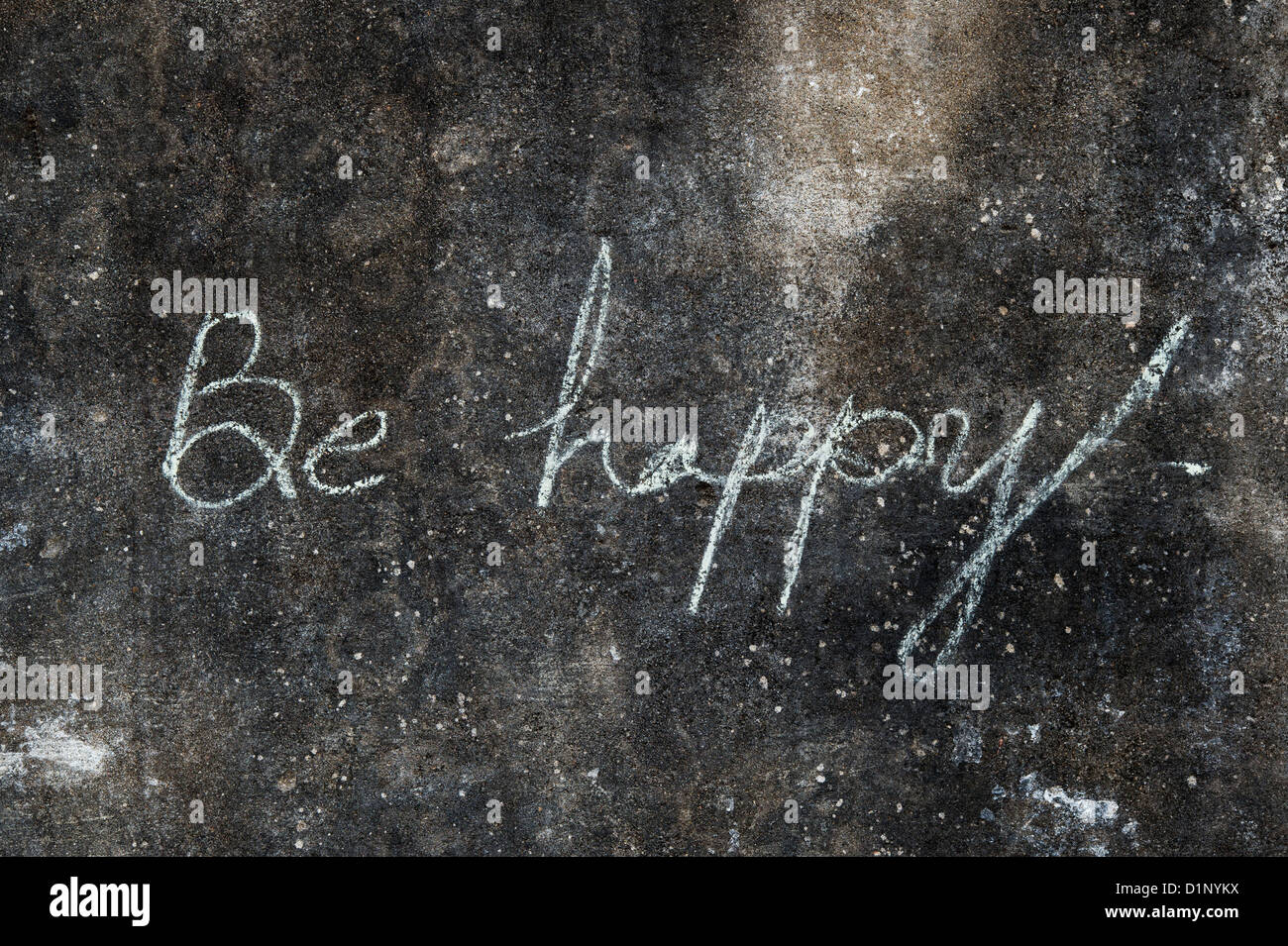 BE HAPPY written in chalk on a stone - Stock Image
