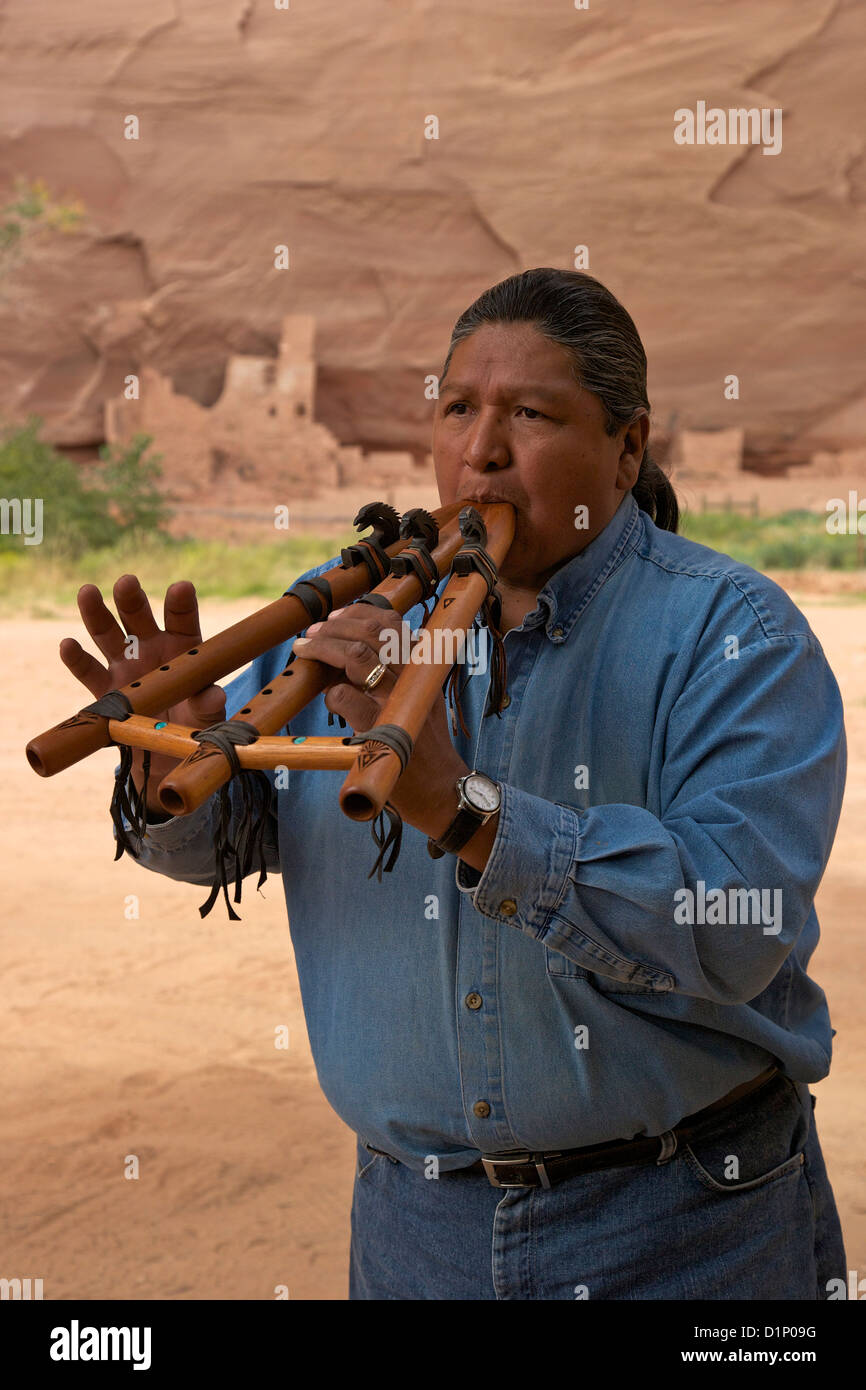 Travis Terry playing flute in his native Canyon de Chelly National Monument, Arizona, USA - Stock Image