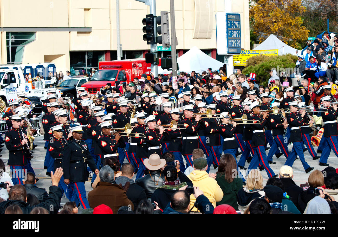 Members of the U.S. Marine Corps West Coast Composite Band make their way along the parade route during the 124th - Stock Image