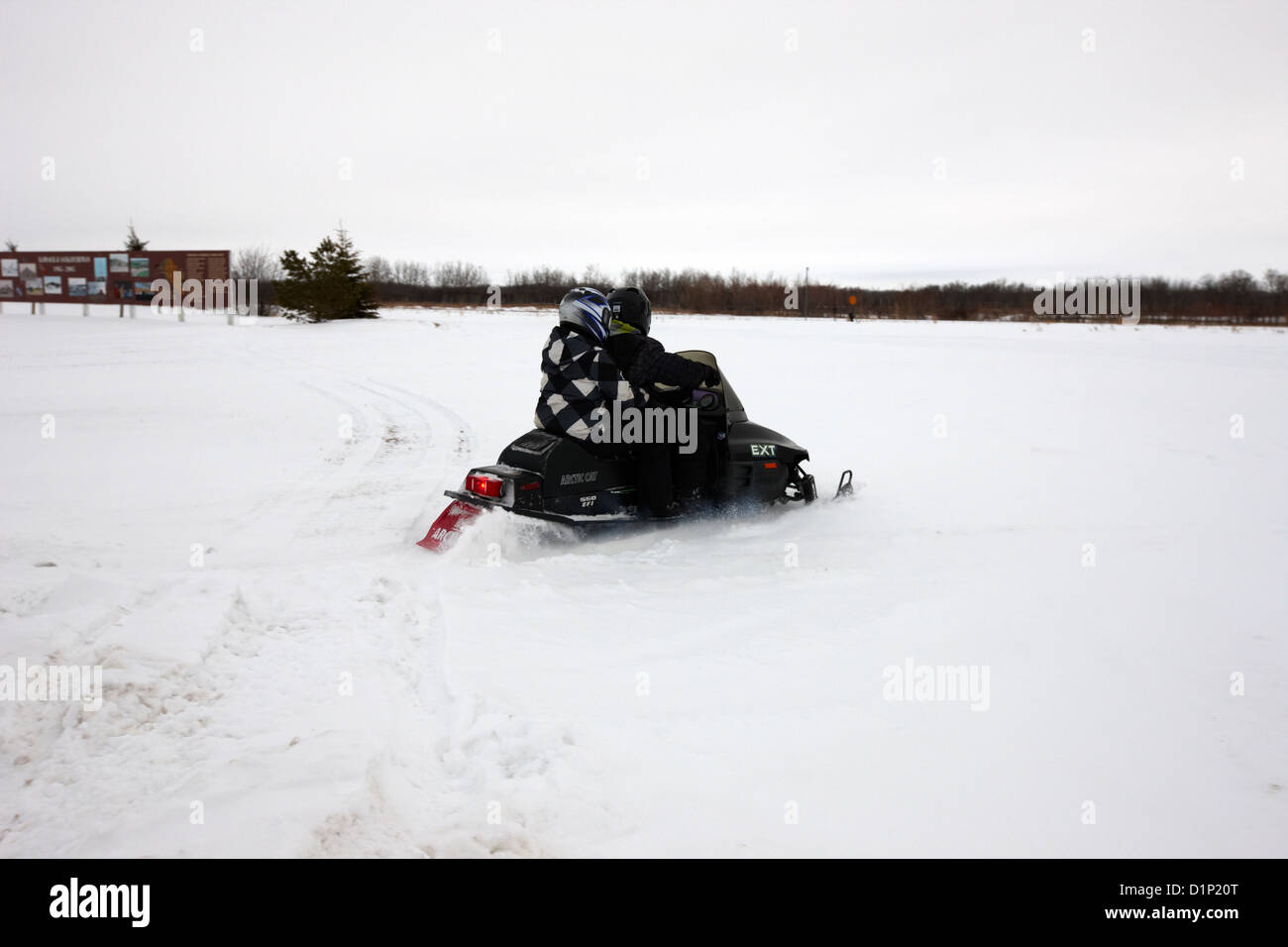 couple on a snowmobile going cross country Kamsack Saskatchewan Canada - Stock Image