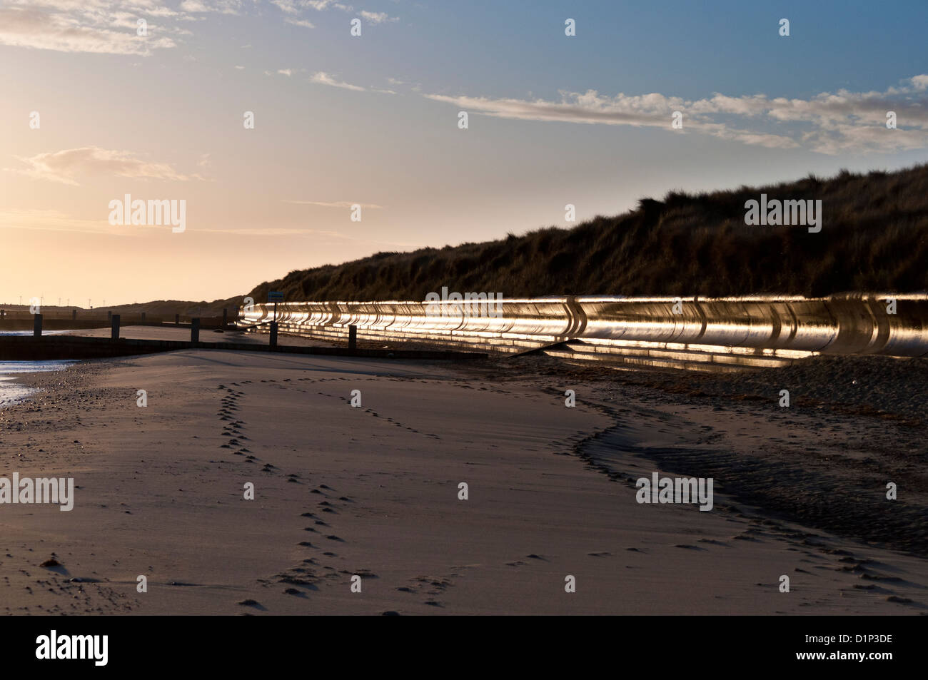 Curved concave concrete sea wall Winterton dunes in morning dawn light - Stock Image