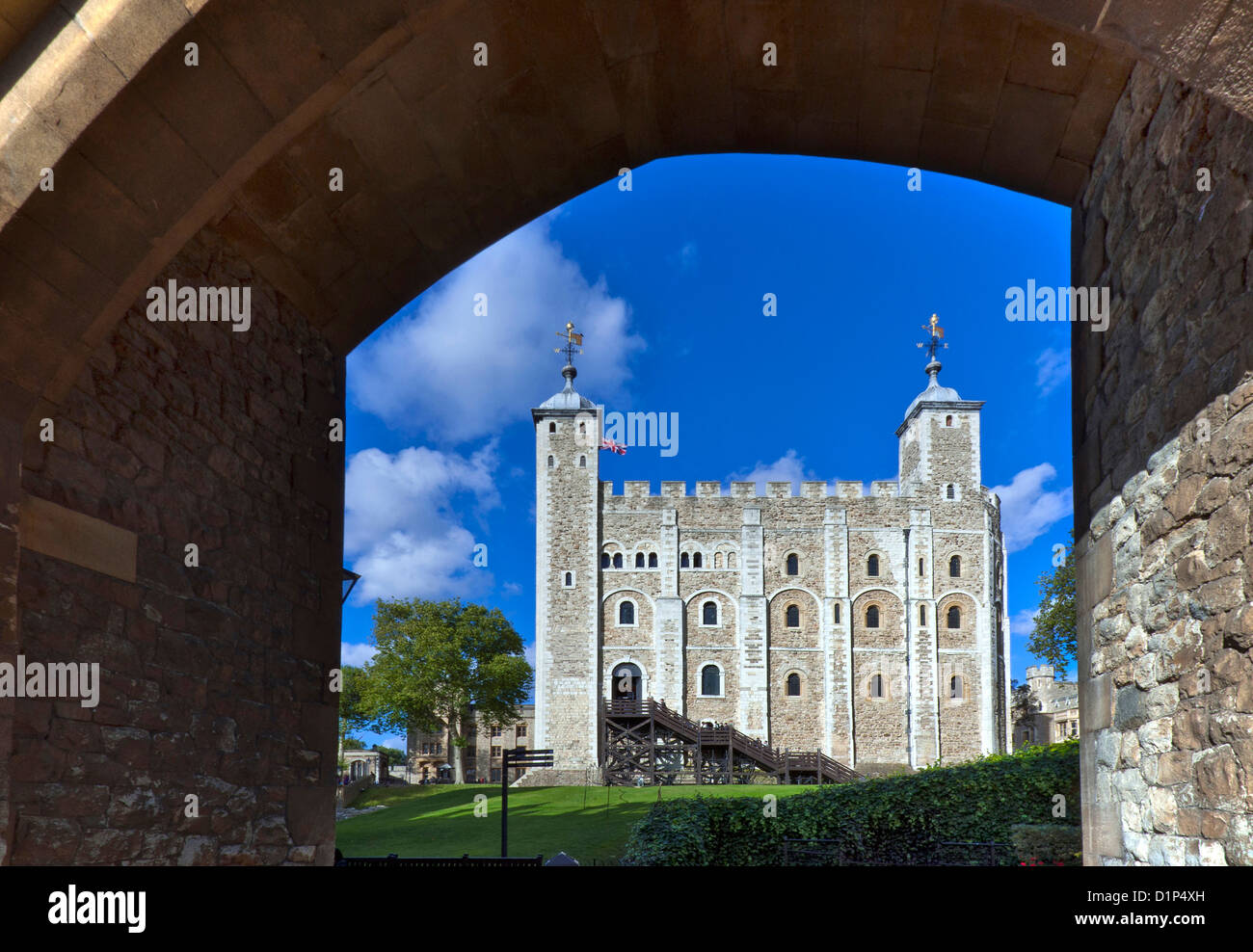 The White Tower at The Tower of London viewed through stone entrance archway London EC3 UK - Stock Image