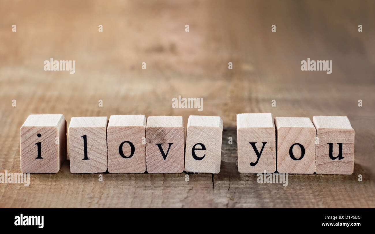 Message I love you spelled in wooden blocks with copy space - Stock Image