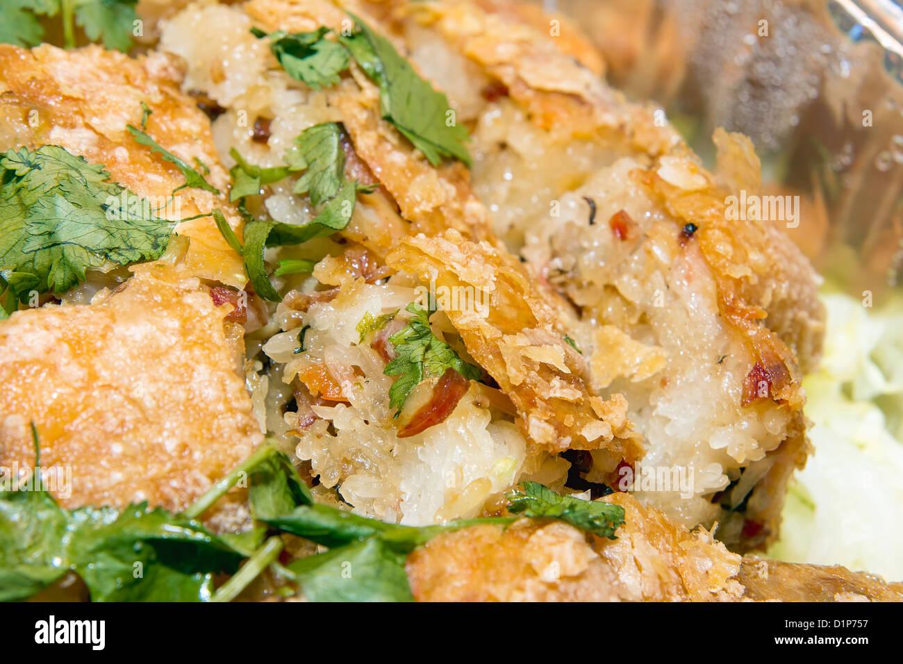 Chinese Deep Fried Chicken Stuffed with Glutinous Rice Sausage Dried Shrimp Black Mushroom and Cilantro Macro - Stock Image
