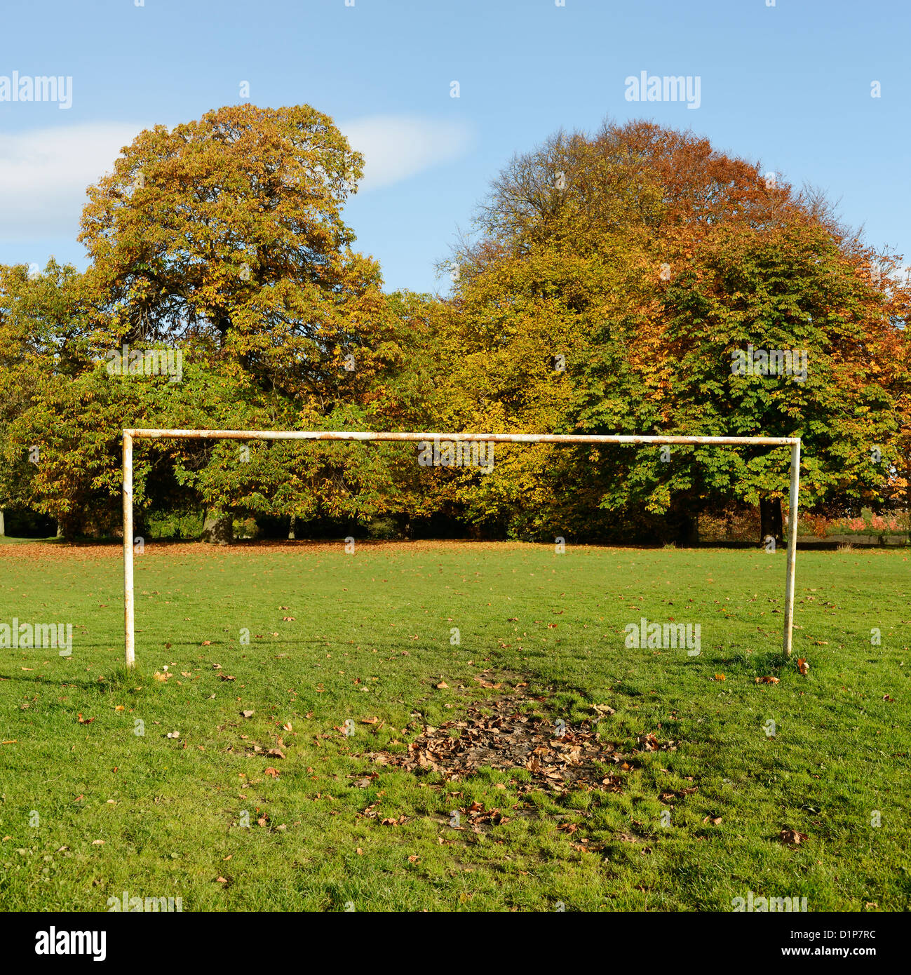 Old football goal posts in a park - Stock Image