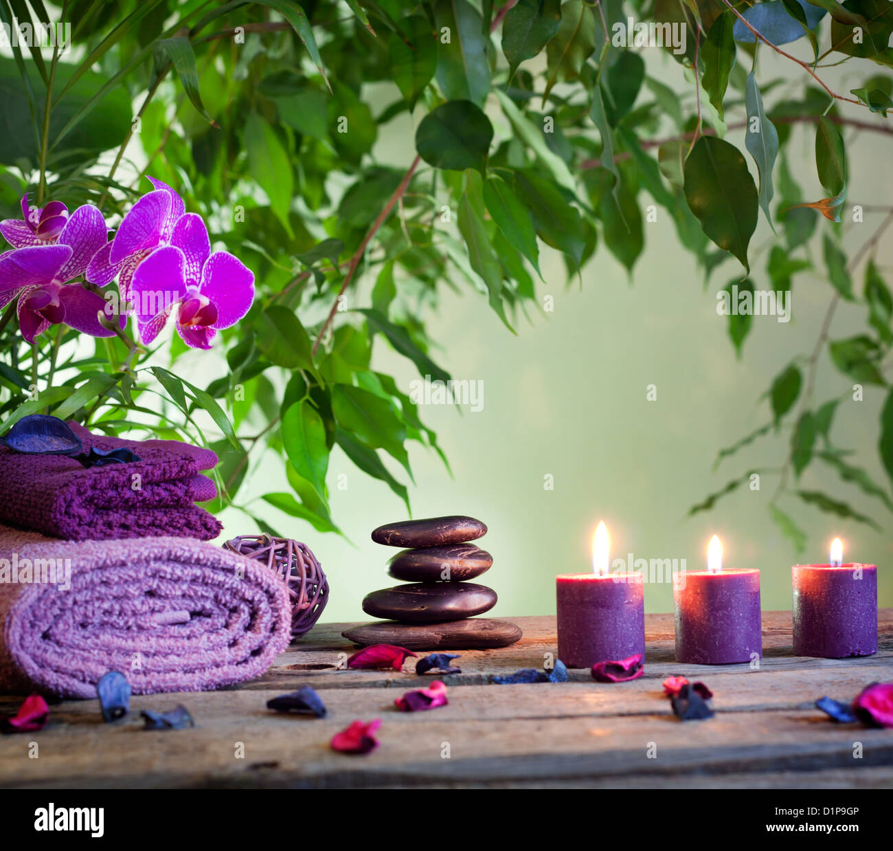 Spa still life with zen stones aromatic candles and orchid - Stock Image