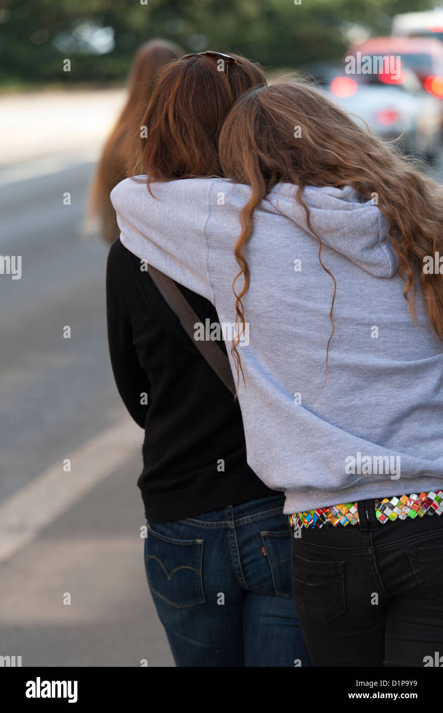 Back view of daughter hugging her mother, District 2, Zurich, Switzerland - Stock Image