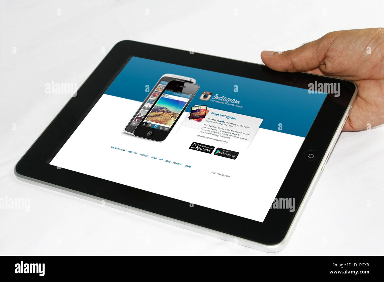 A person using Apple iPad tablet computer - Stock Image