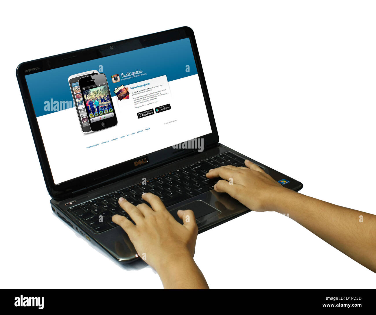 A person using a laptop computer isolated on white background - Stock Image