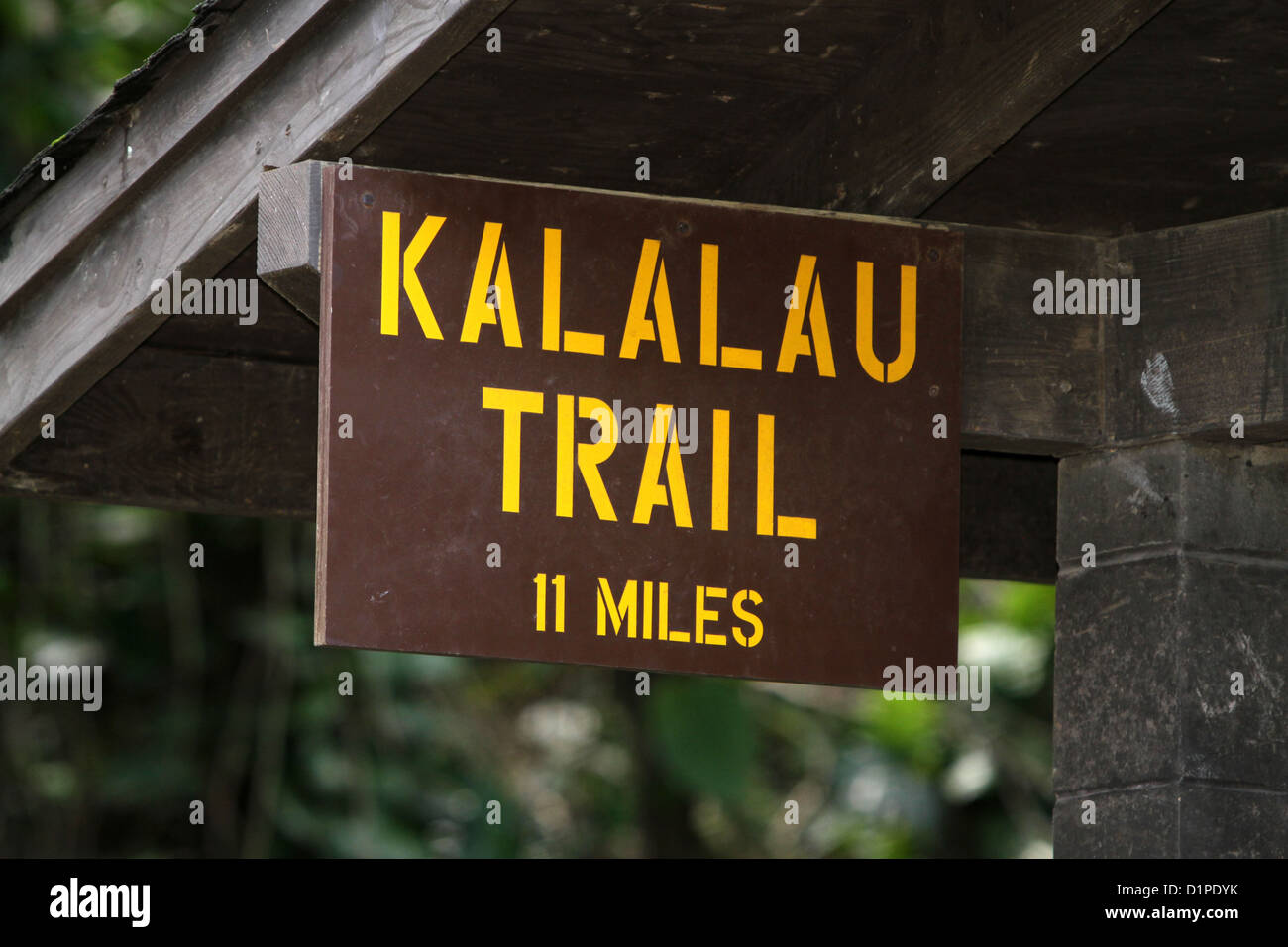 Kalalau trail head sign marking a trail along the Na Pali Coast on the island of Kauai, Hawaii, USA. - Stock Image