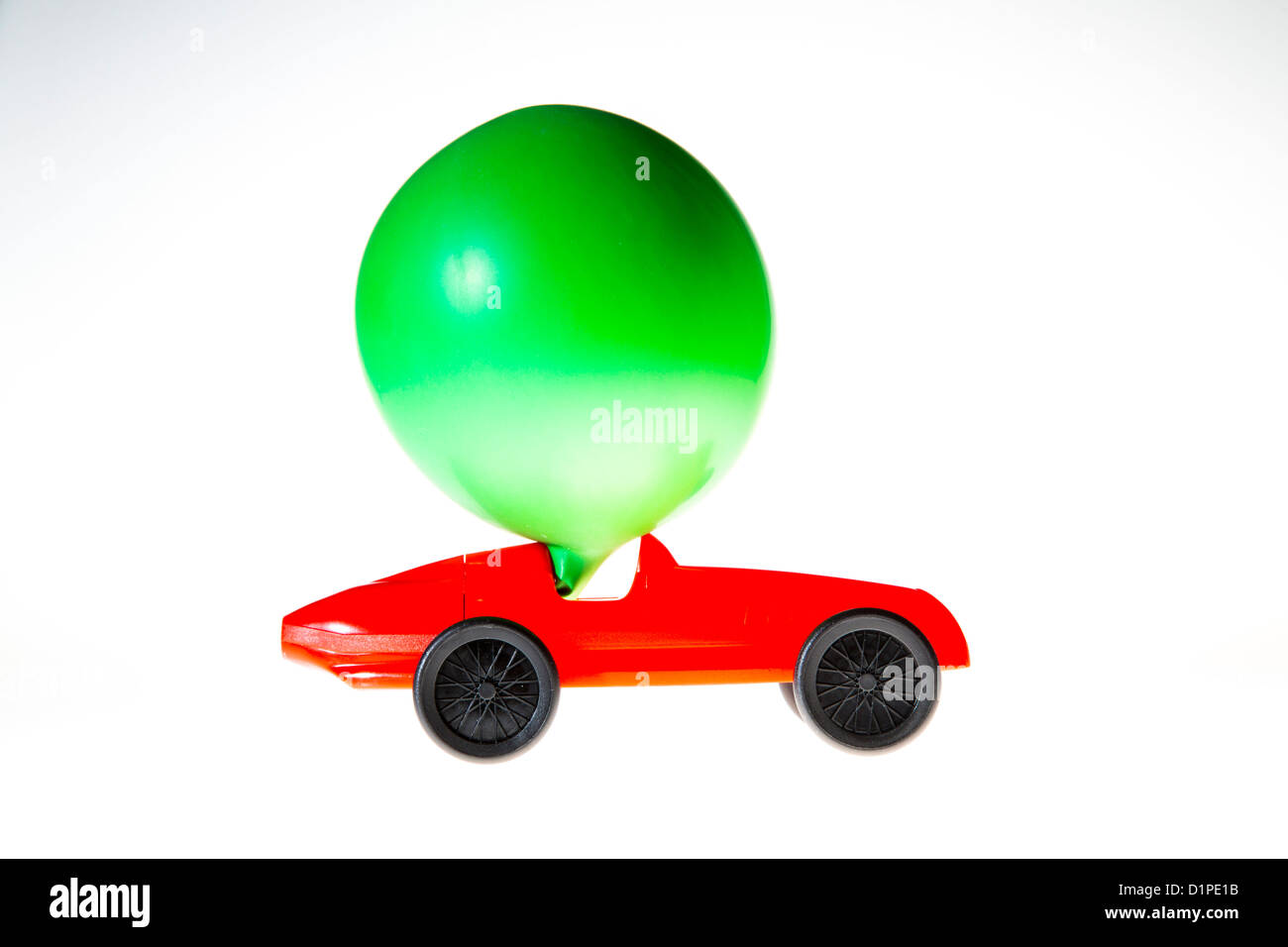 Toy car, powered by the air of a blown up balloon. The effluent air drives the car forward. Symbol image, alternative - Stock Image
