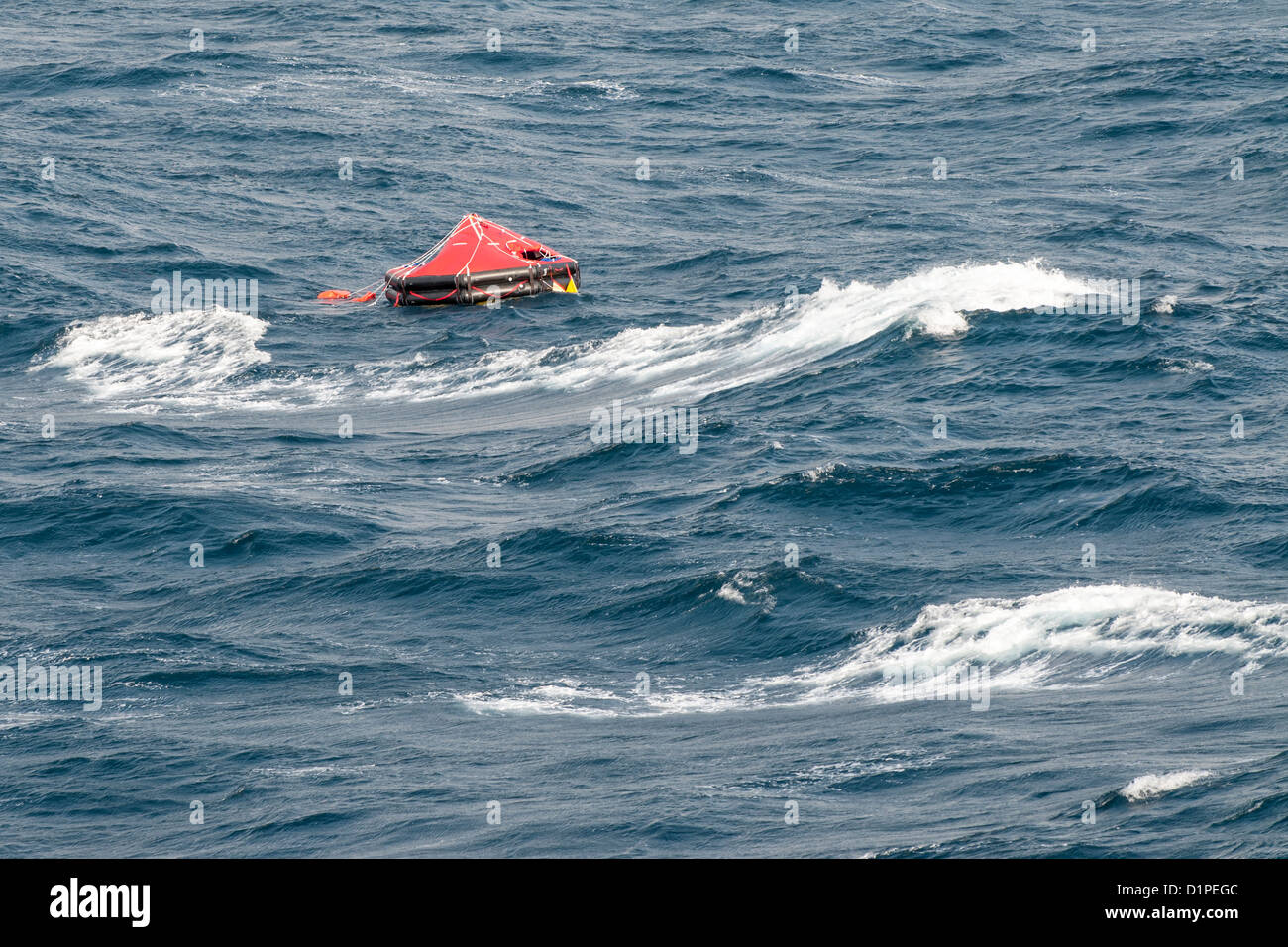Inflatable Lifeboat, inflated Life Raft in the rough sea - Stock Image