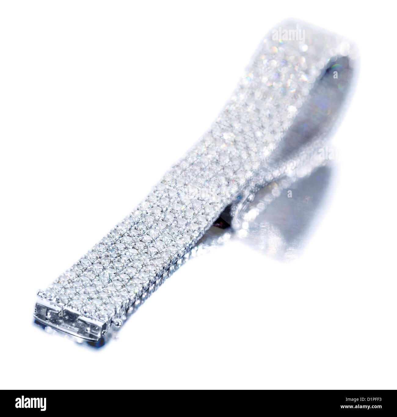 Diamond bracelet against white background - Stock Image