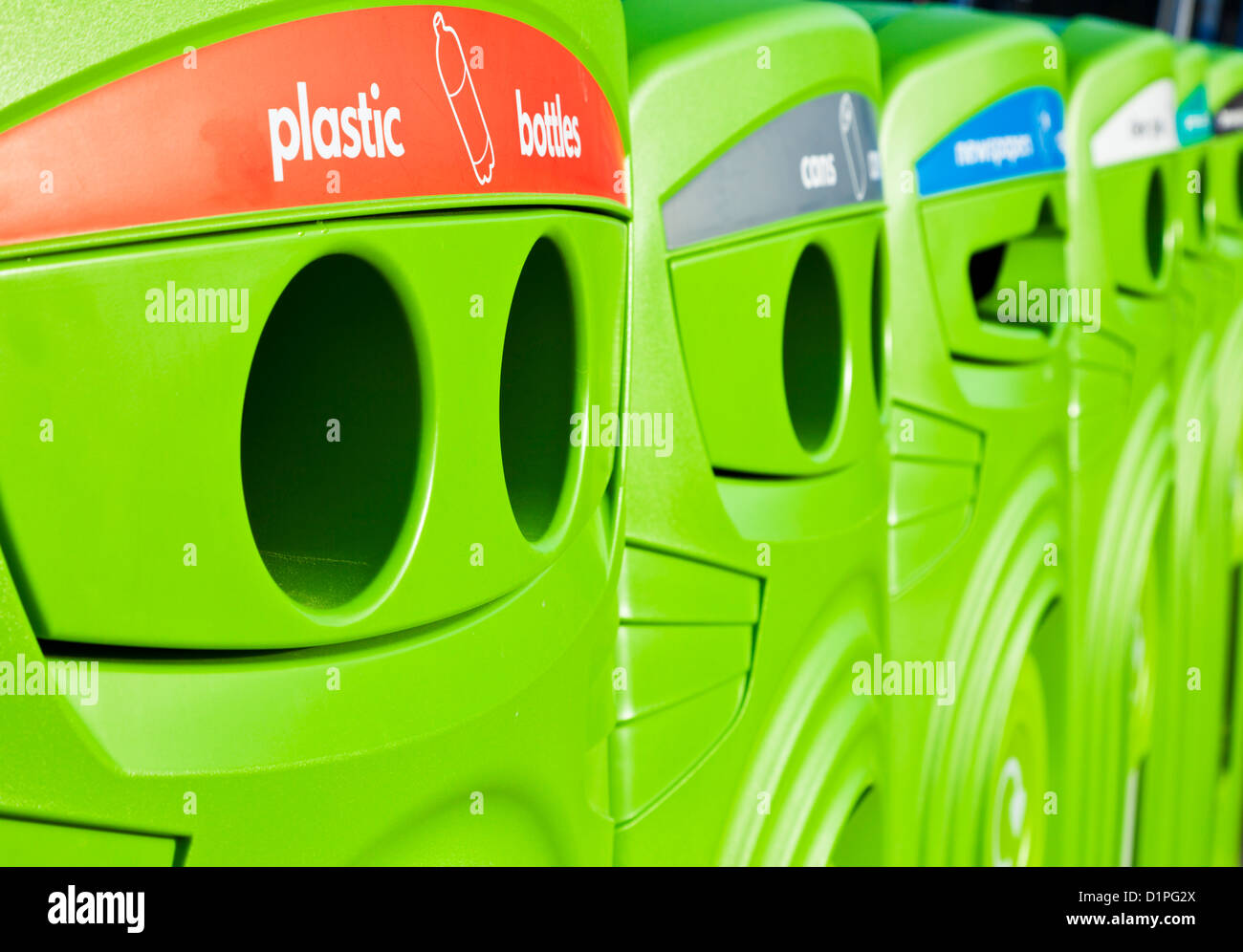 Bright green recycling bins in a row in a town centre England UK GB EU Europe Stock Photo