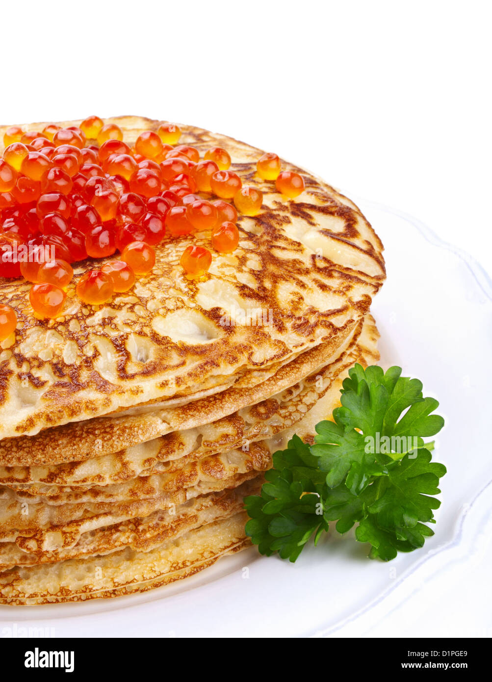 Stack of pancakes with salmon caviar over white background - Stock Image