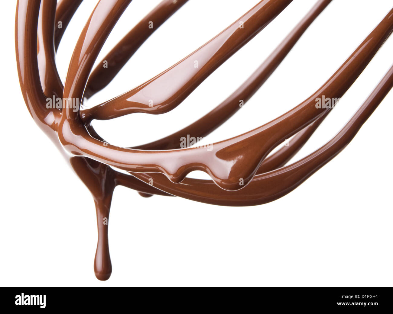whisk with melted chocolate over white background - Stock Image