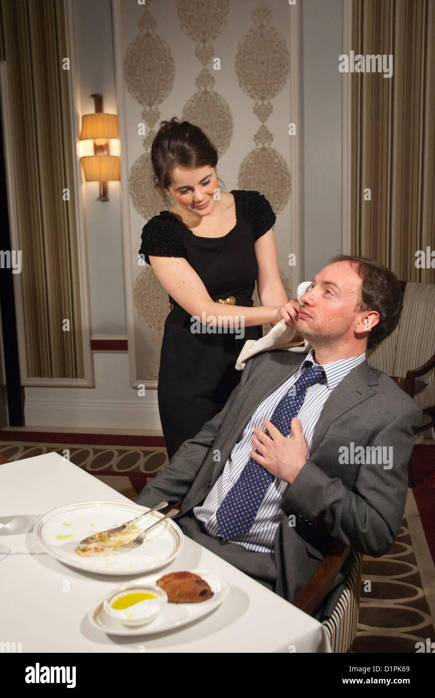 Couple that have eaten and drunk too much at a restaurant. - Stock Image
