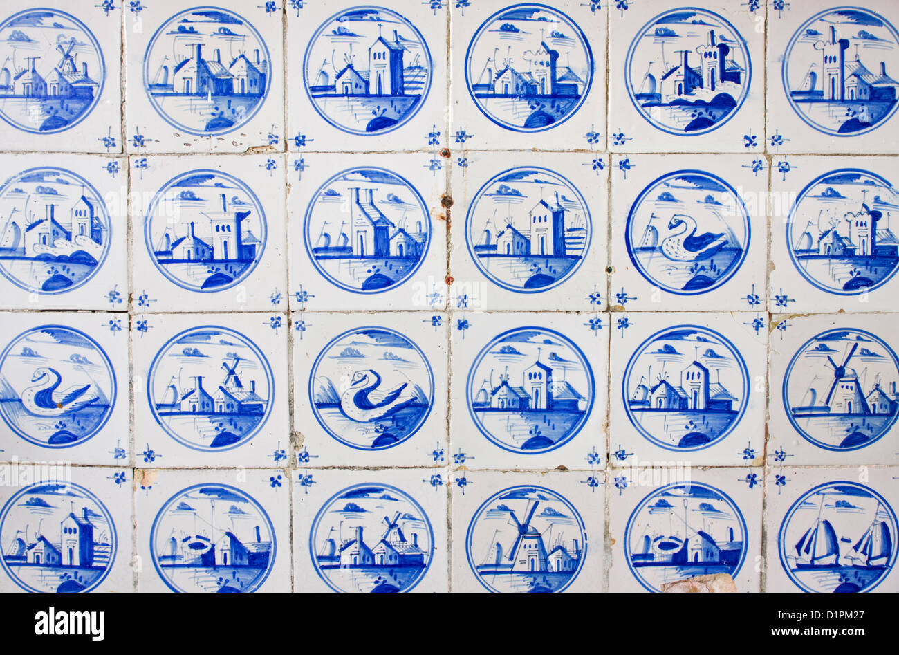 Antique, handpainted dutch tiles on the kitchen wall of an old building - Stock Image