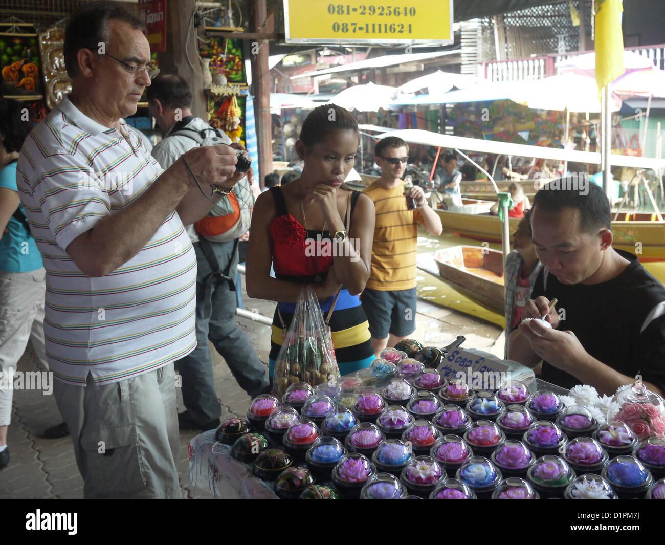 Asian art market tourist - Stock Image