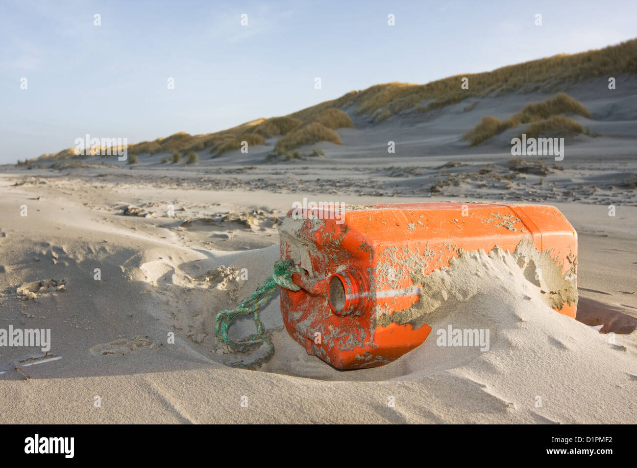Plastic garbage, washed ashore on a beach. - Stock Image