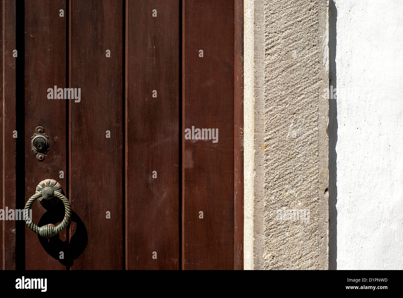 Old wood door in a village house - Stock Image