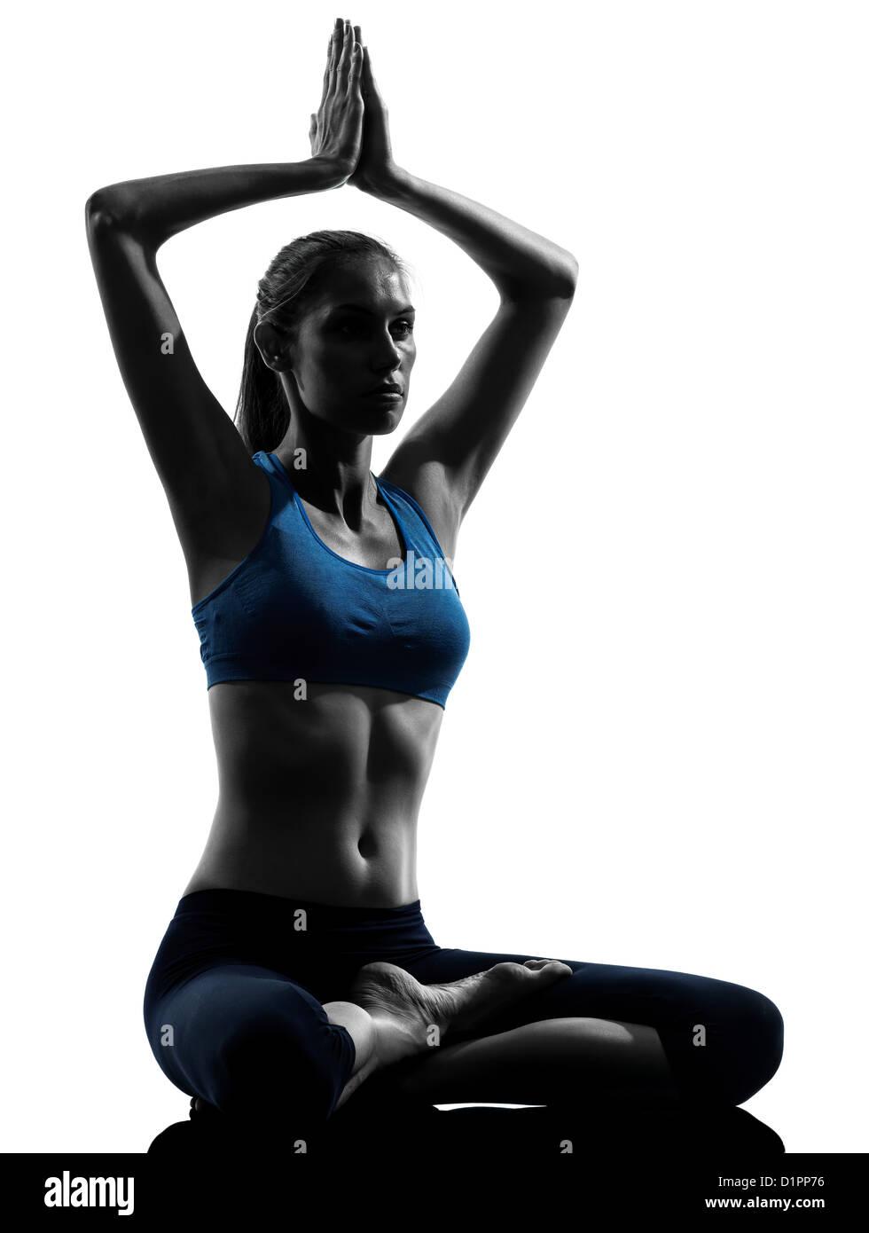 One Woman Exercising Yoga Sukhasana Easy Pose In Silhouette Studio Isolated On White Background - Stock Image
