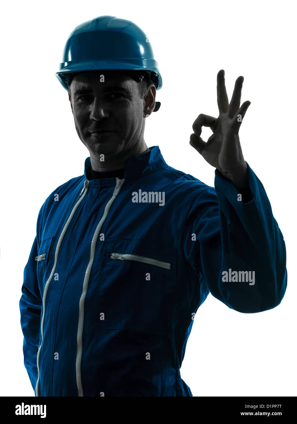 one  man construction worker smiling silhouette portrait okay gesture in studio on white background - Stock Image
