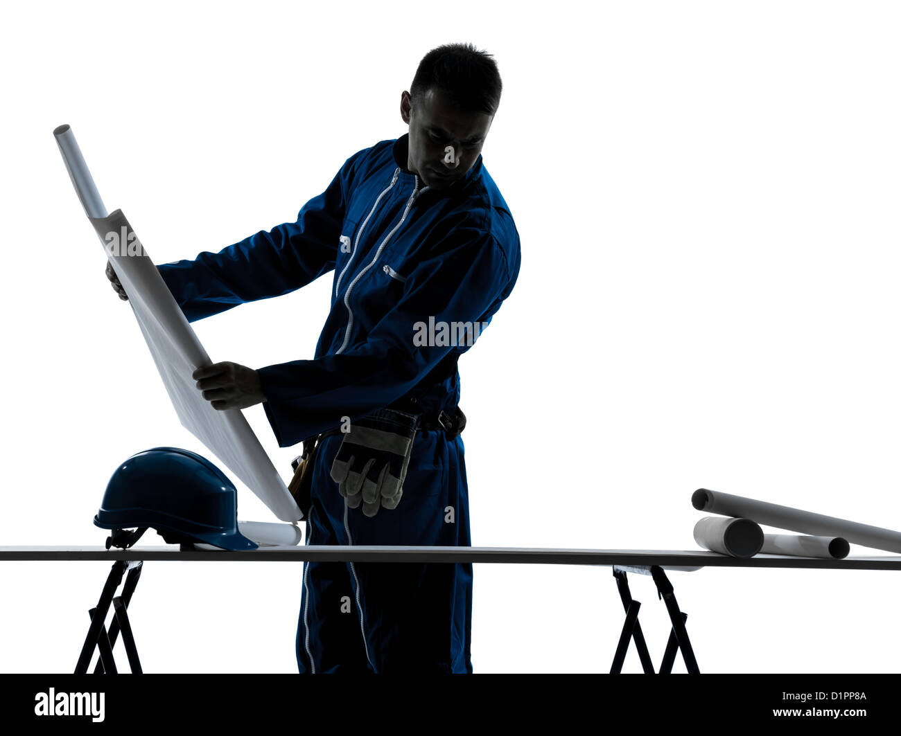 one  man construction Architect working plans silhouette in studio on white background - Stock Image