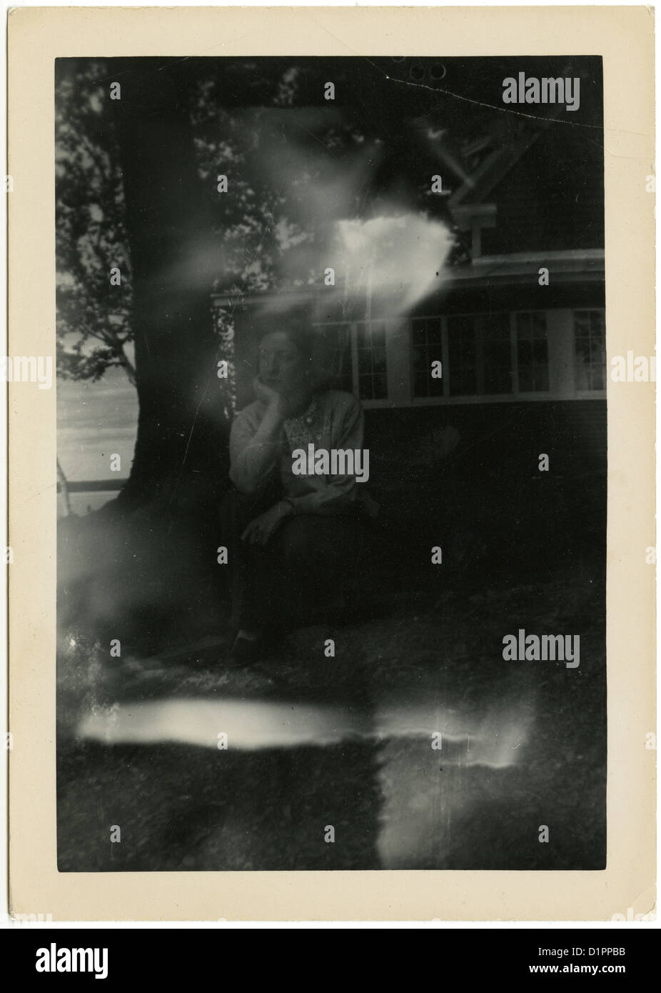 Circa 1940 photograph with a ghostly double exposure. - Stock Image
