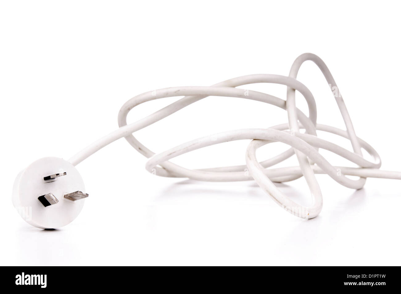 White electrical cord plug isolated on white - Stock Image