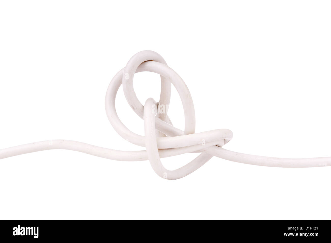 Electrical wire tangled in a knot isolated on white - Stock Image