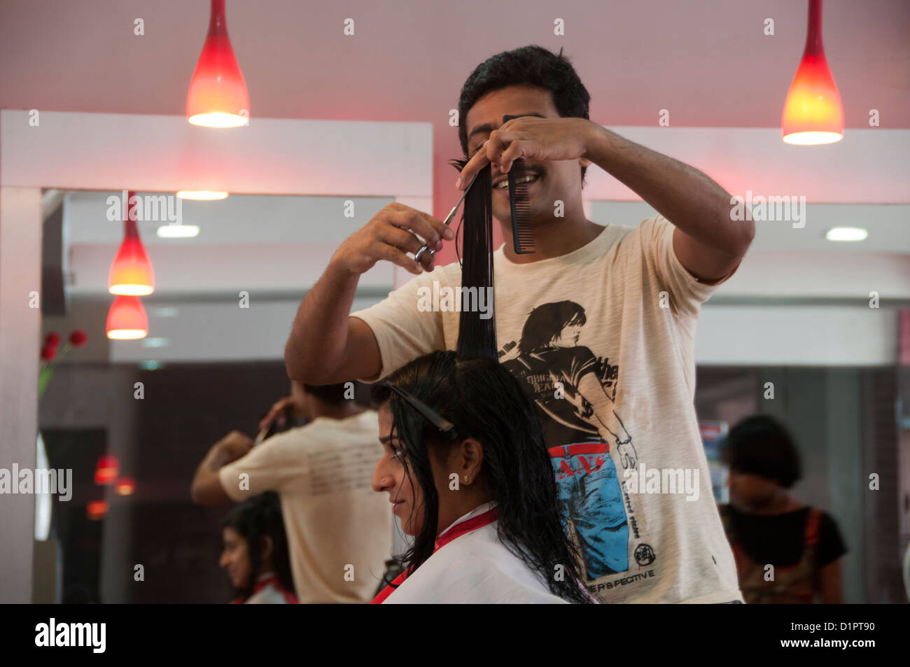 Woman getting hair cut in a Hair beauty  salon, India - Stock Image