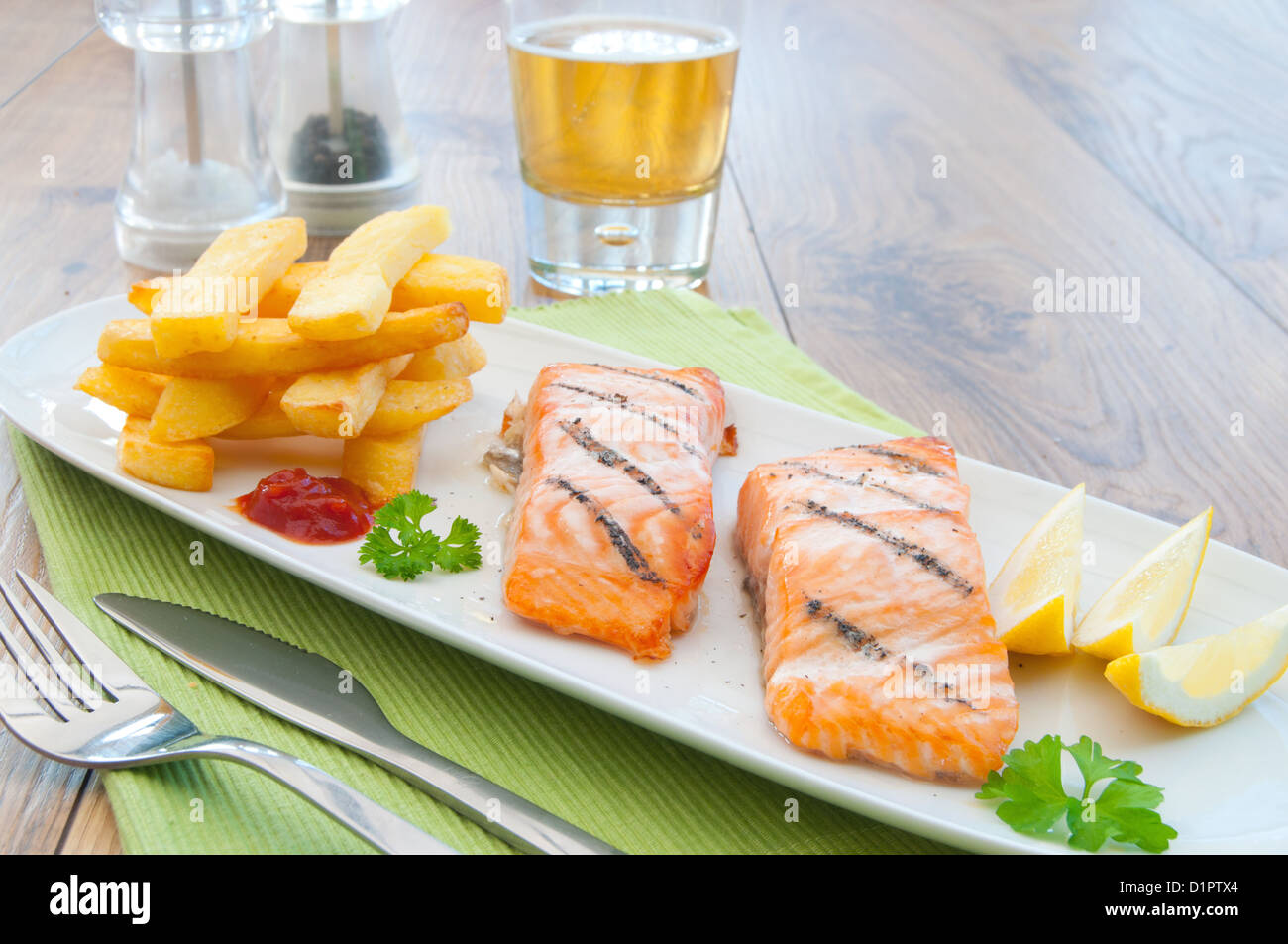 Grilled salmon fillets with chips - Stock Image