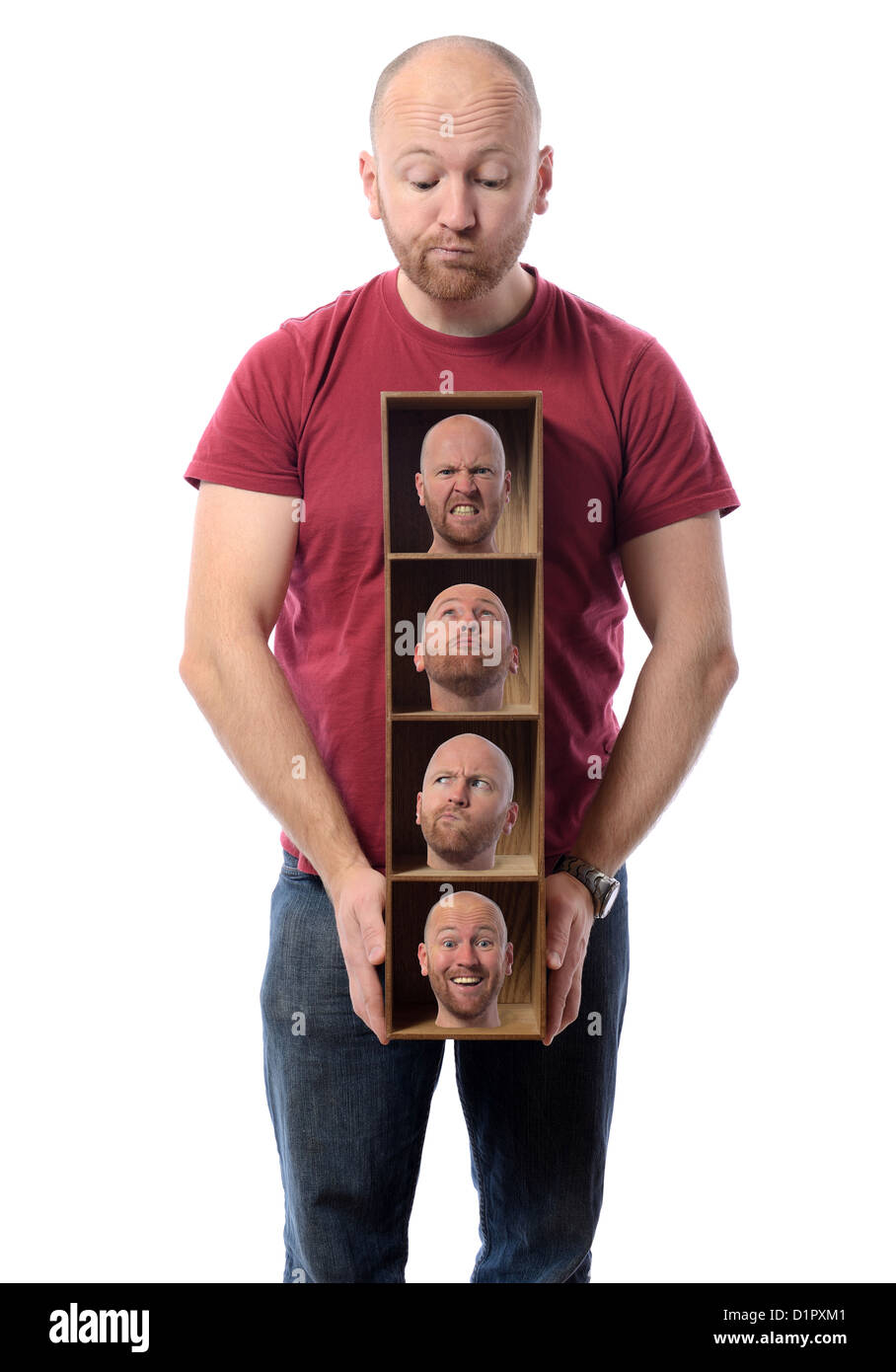 Man choosing Many faces concept symbolizing different emotions or multiple personalities. - Stock Image