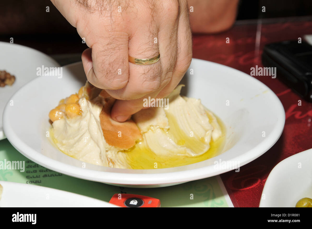 A serving of Humus, tahini and Olive oil - Stock Image