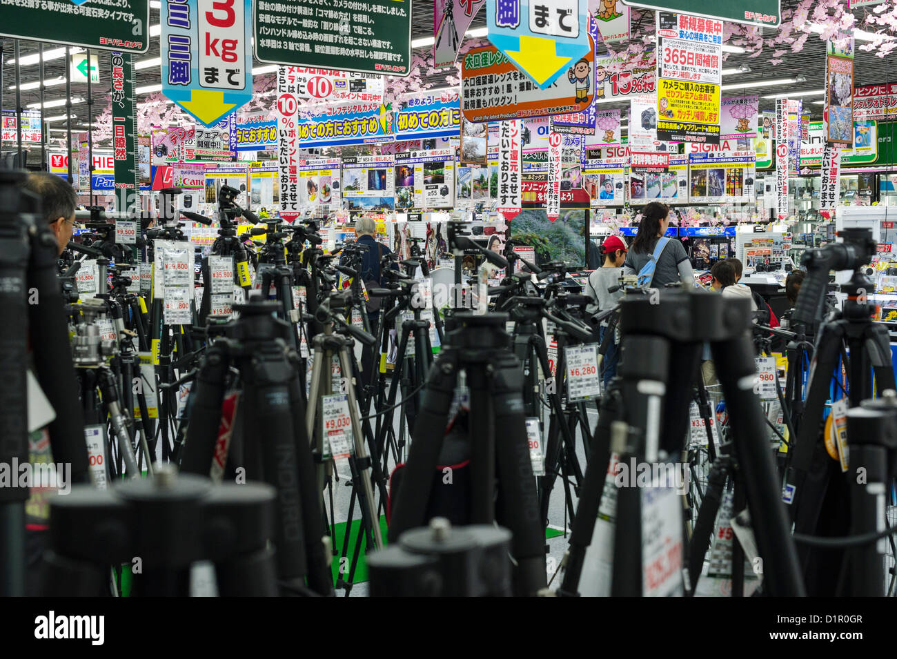 Tripods in Japanese camera store, Tokyo - Stock Image