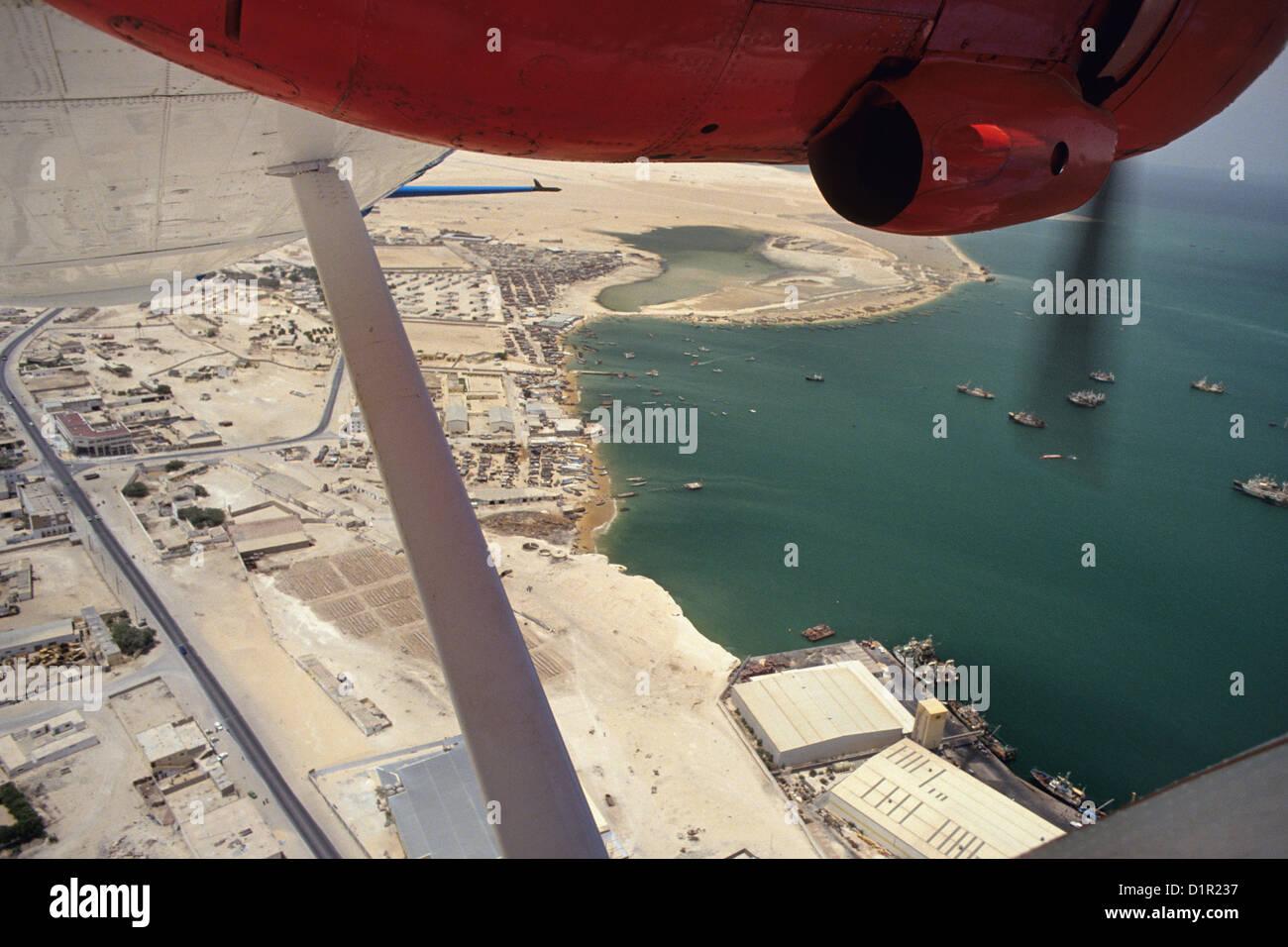 Mauritania, Nouadjibou, Catalina PBY-5A hydroplane. View on fish harbour. - Stock Image